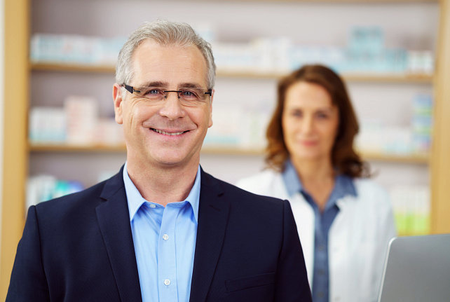 two people at the pharmacy smiling